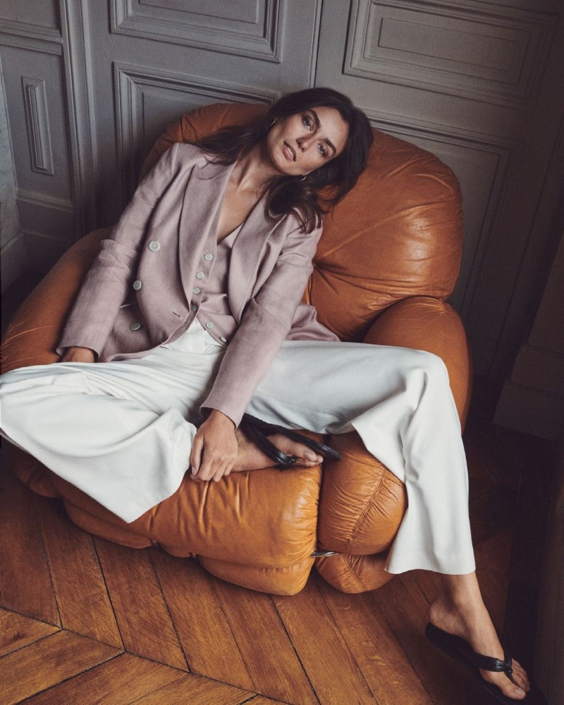 Lounging in style, Andreea Diaconu poses in Massimo Dutti's minimal summer 2021 designs.