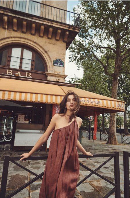 Andreea Diaconu poses in Massimo Dutti asymmetric dress.