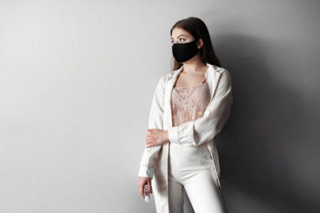 Model Black Face Mask White Jacket Pants Outfit