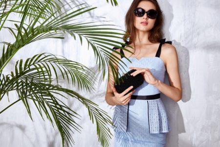 Model Blue Dress Holding Black Clutch Bag
