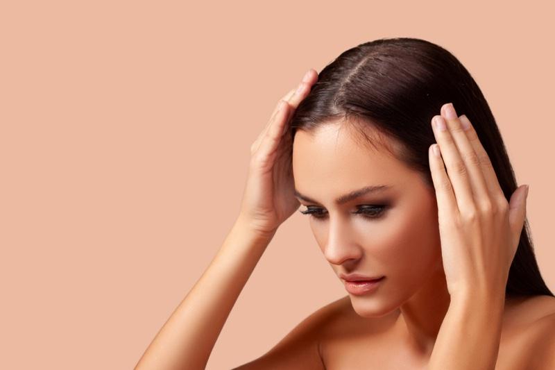 Model Touching Hair Worrying Thinning