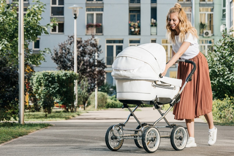 Mother Smiling Walking baby Stroller