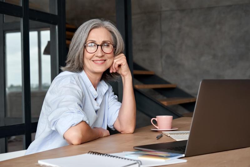 Older Woman Grey Hair Glasses Sitting Laptop