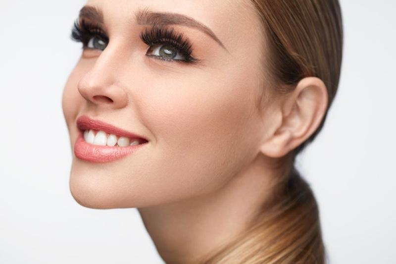 Smiling Model Beauty False Eyelashes Makeup