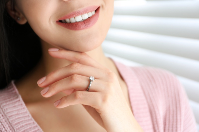 Smiling Woman Cropped Engagement Ring Hand