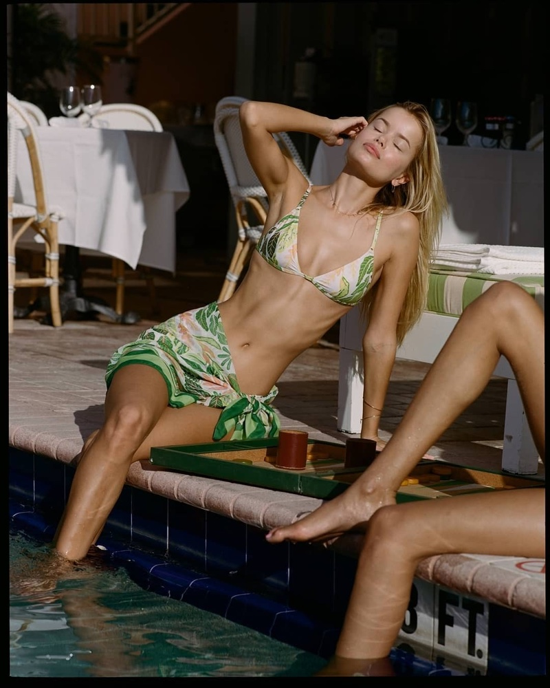 Frida Aasen poses in Solid & Striped The Lulu and Pareo in Palm Leaf Print.