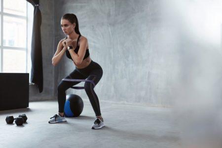 Squatting Model Fitness Exercise