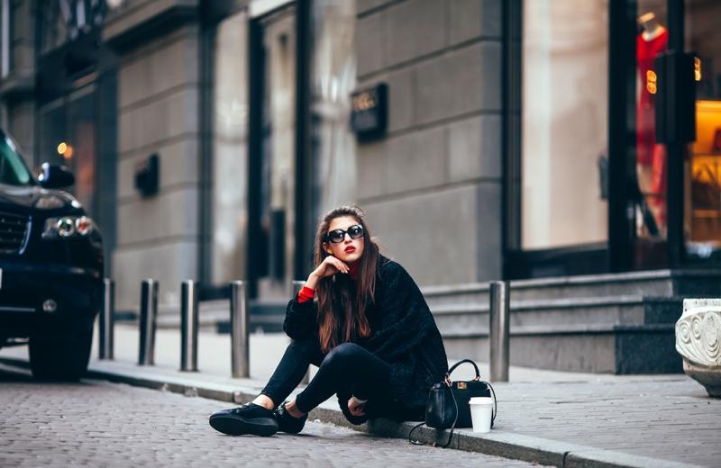 Stylish Woman Black Outfit Sitting Street