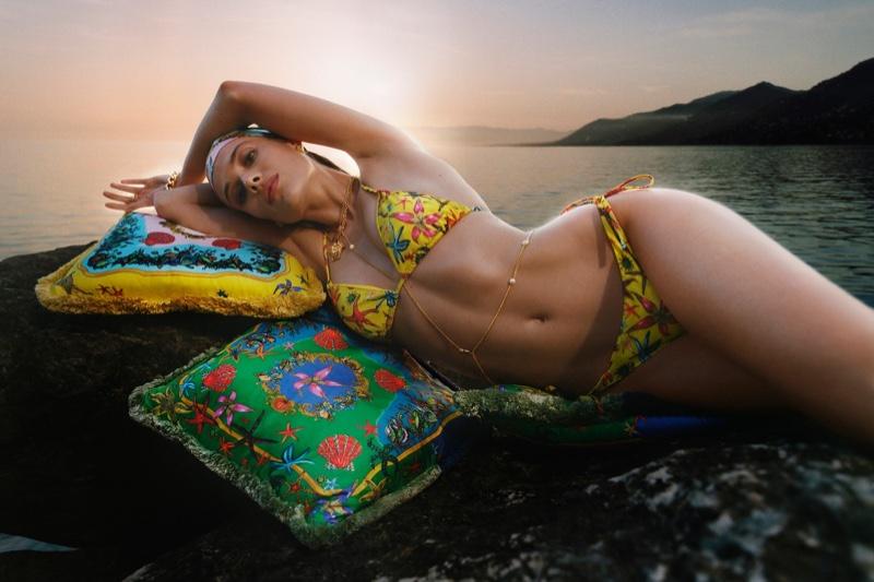 Versace highlights its signature prints in La Vacanza 2021 beachwear campaign.
