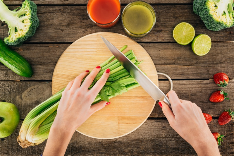 Woman Cutting Up Celery