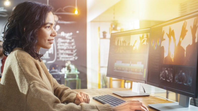 Woman Editing Video Computer