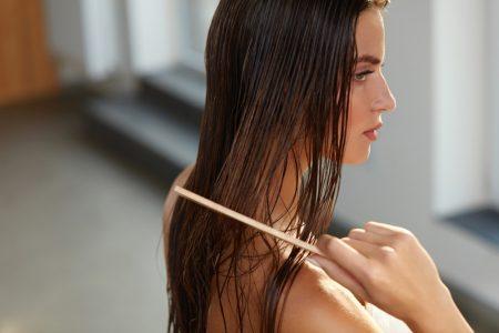Woman Long Wet Hair Comb