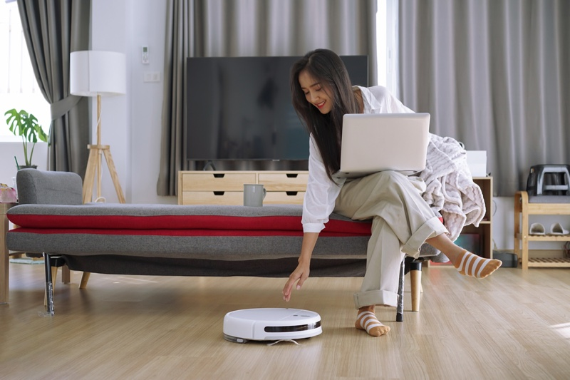 Woman Robot Vacuum Home Cleaning Laptop