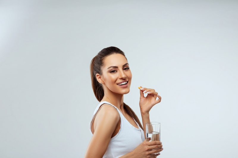 Woman Taking Supplements Glass Water