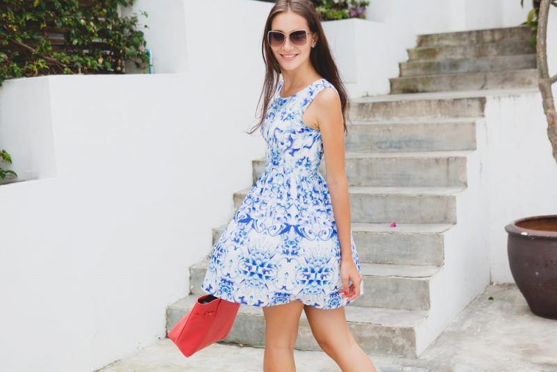 Woman in Blue and White Dress