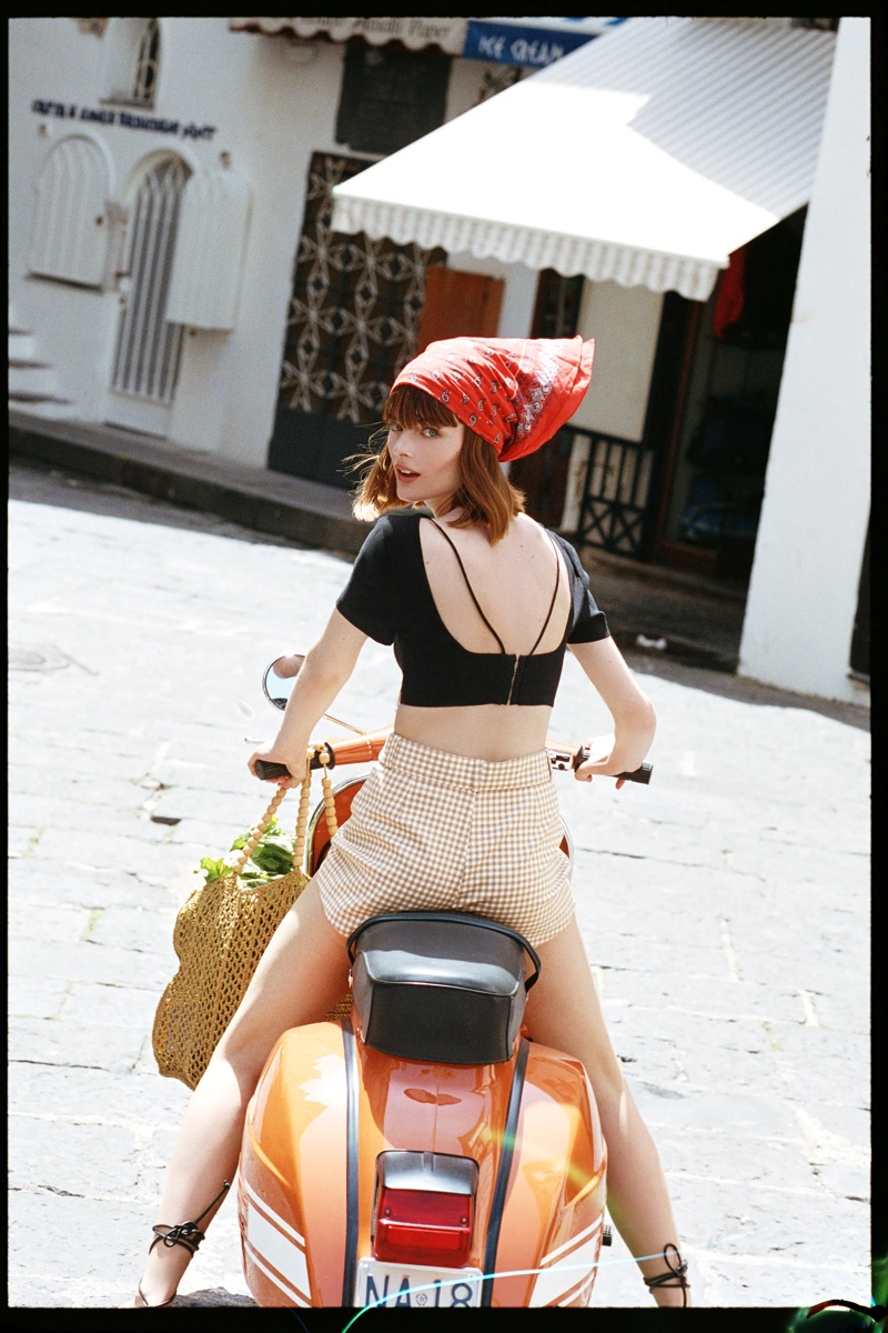 Posing on a vespa, Aylah Peterson poses in Italy for Zara editorial.