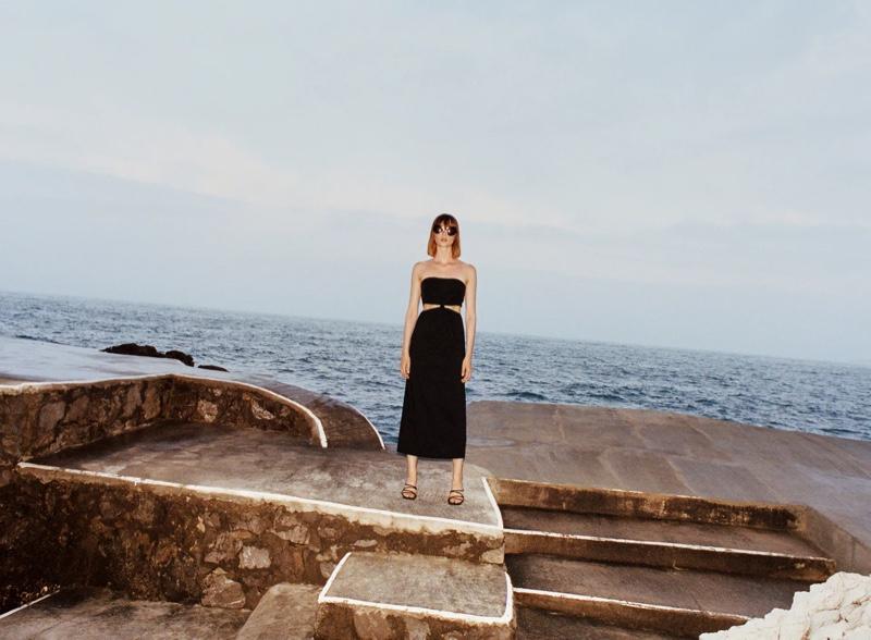Posing seaside, Aylah Peterson wears a little black dress from Zara.