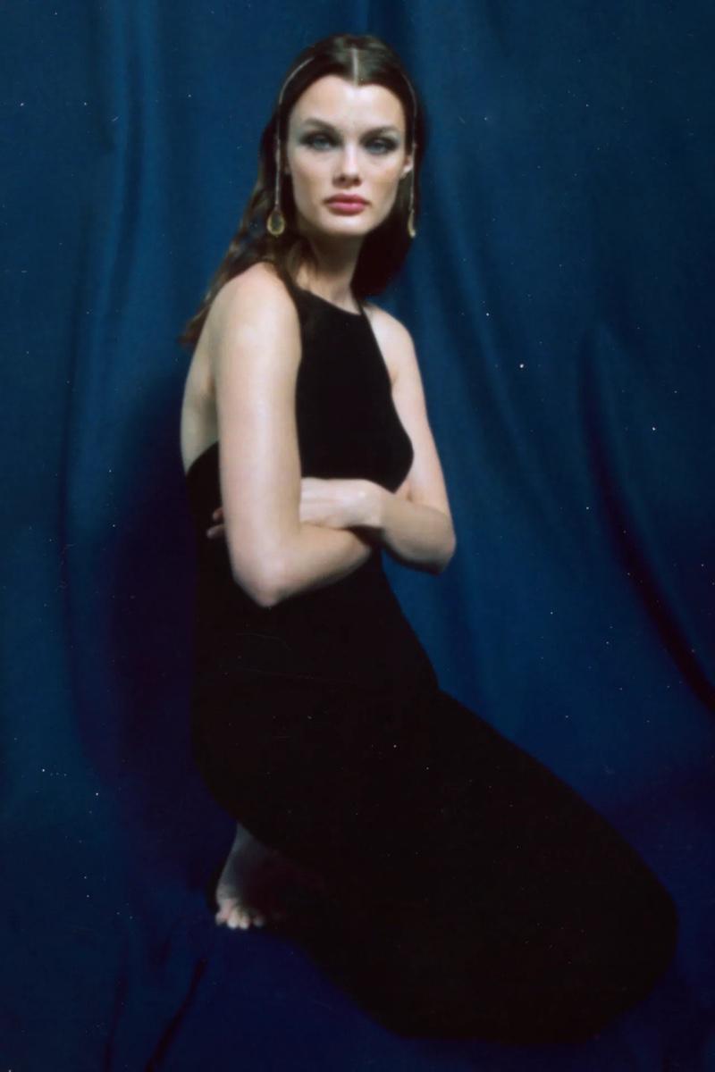Kristina Grikaite poses in Zara's spring-summer 2021 slip dress styles.