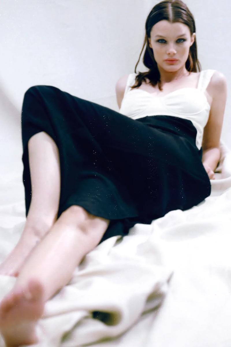 Kristina Grikaite poses in Zara long bustier dress.