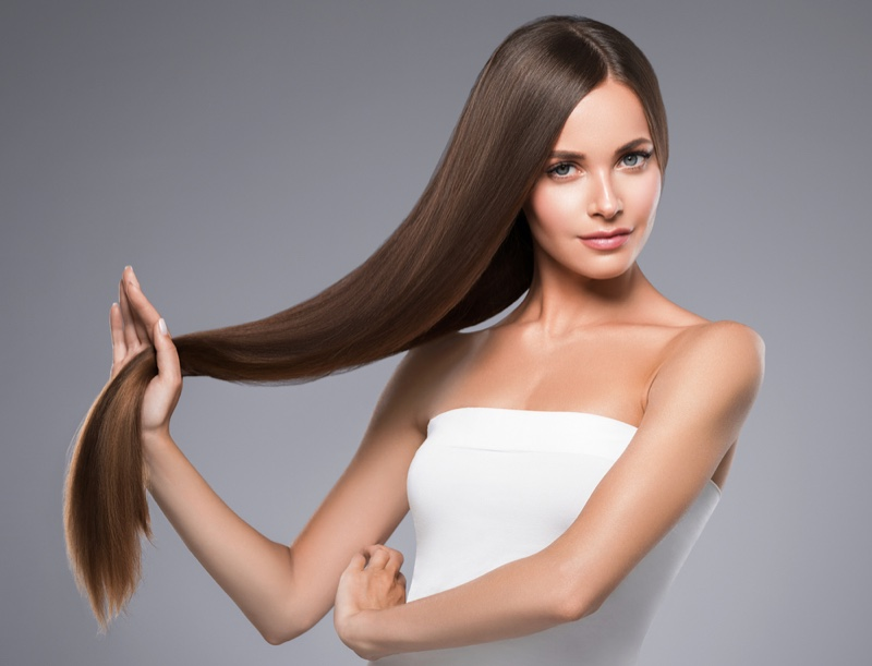 Brown Haired Model Holding Long Straight Hair