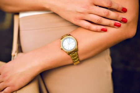Closeup Woman Gold Wrist Watch Red Nails