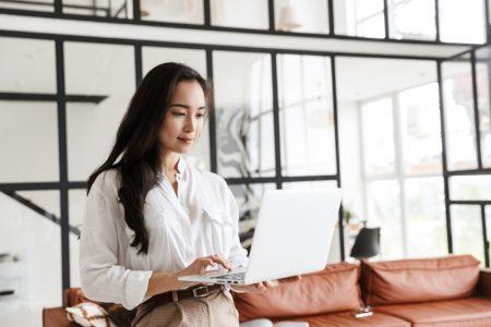 Fashionable Asian Woman Working Laptop