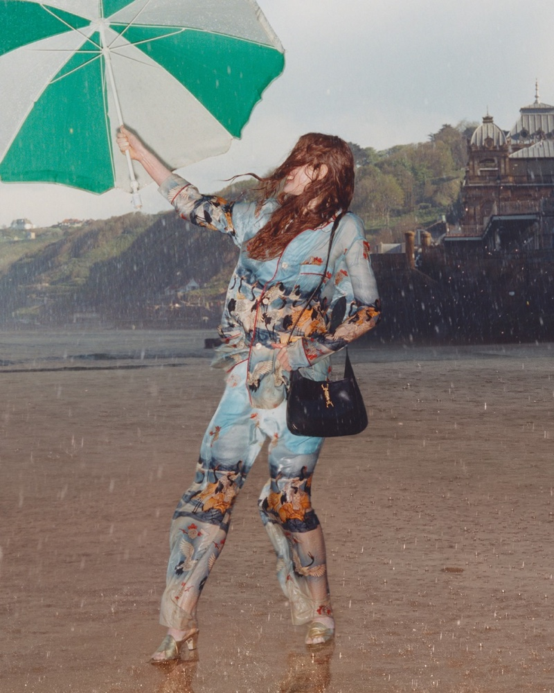 A model poses with an umbrella in Gucci Towards the Sun summer 2021 campaign.