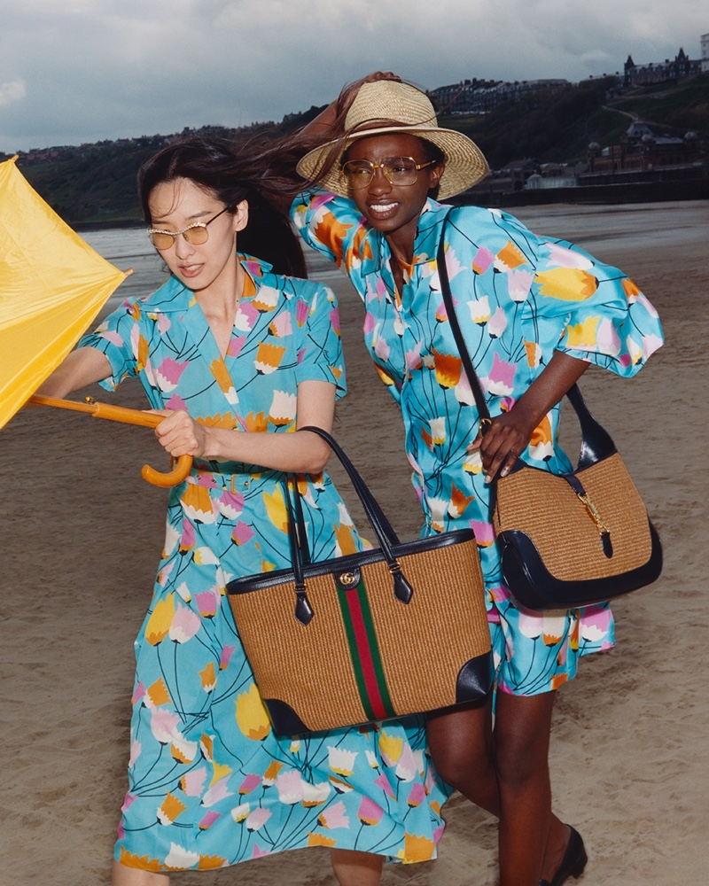 Models pose in floral prints for Gucci Towards the Sun summer 2021 campaign.