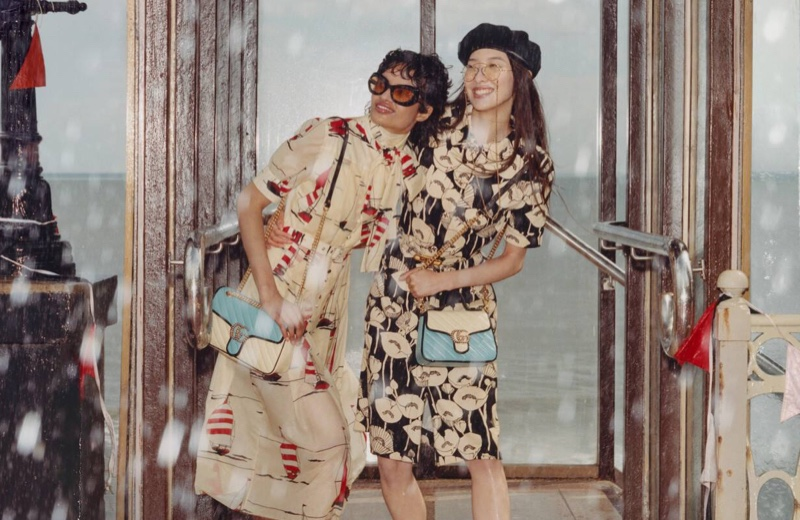Gucci features rainy weather in Towards the Sun summer 2021 campaign.