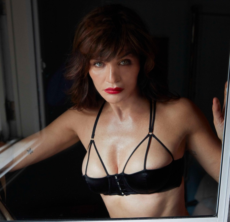 Wearing red lipstick, Helena Christensen fronts Coco de Mer Icons campaign.