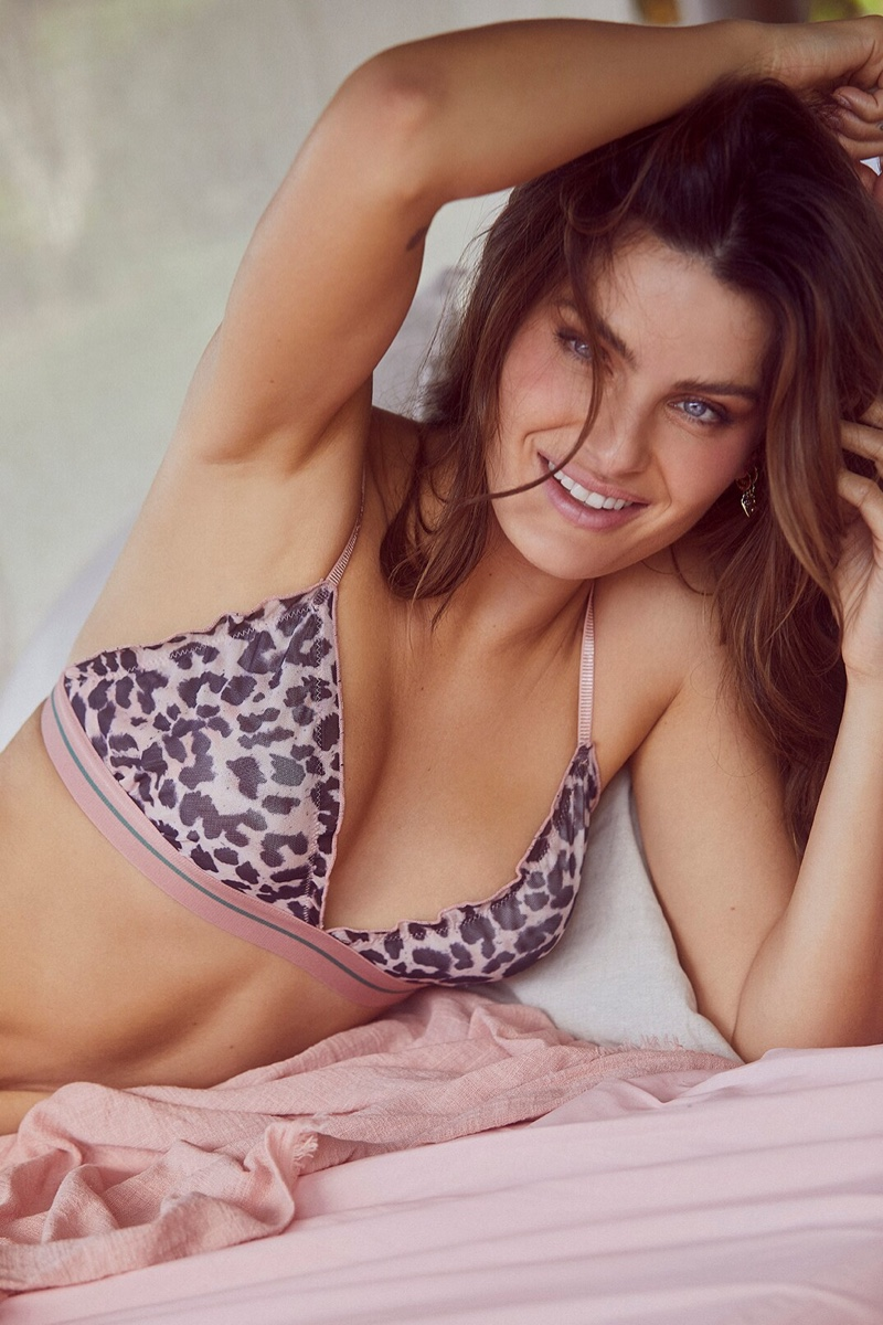 Flashing a smile, Isabeli Fontana poses in Love Stories x Riachuelo lingerie campaign.