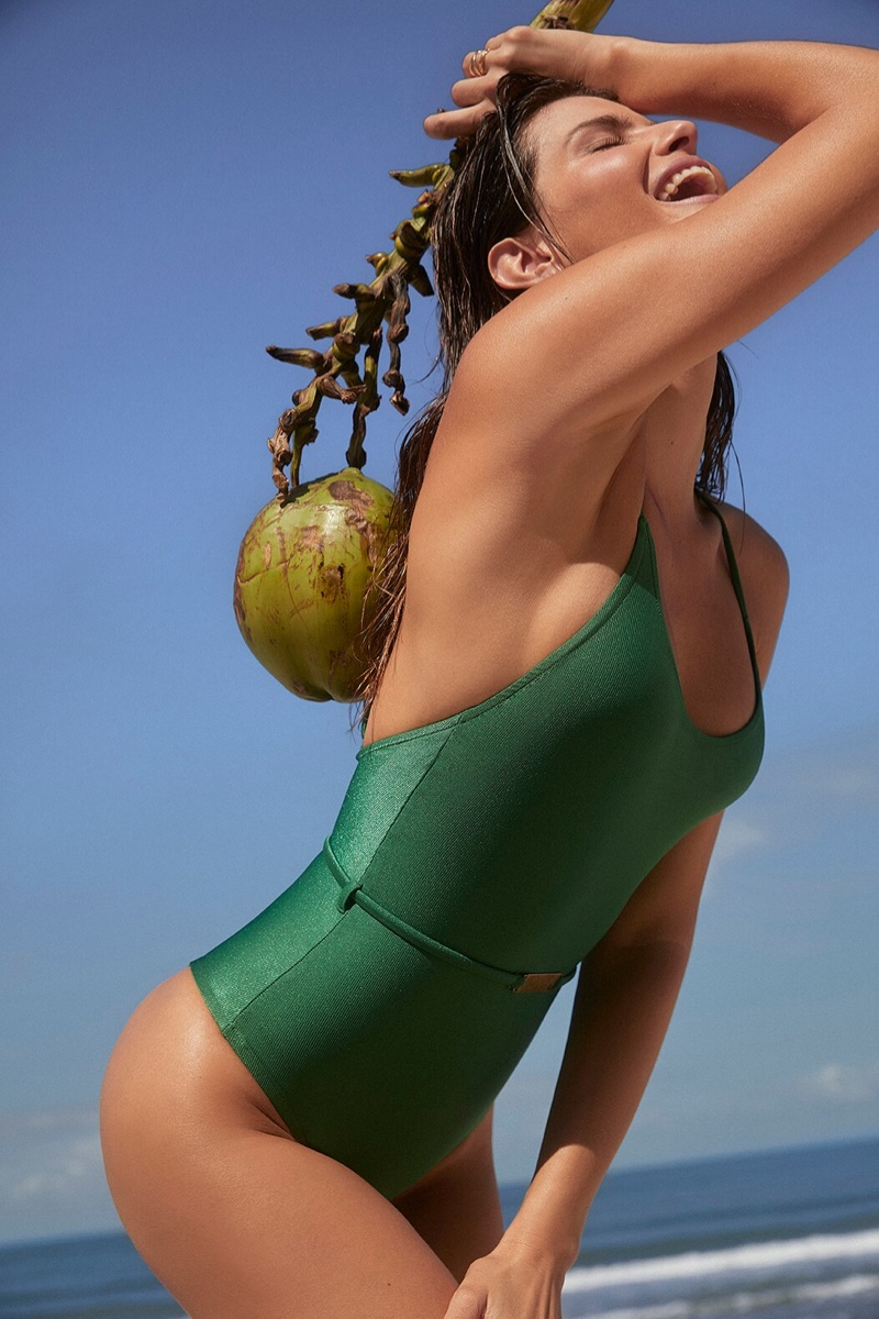 Clad in green, Isabeli Fontana models Love Stories x Riachuelo collaboration.