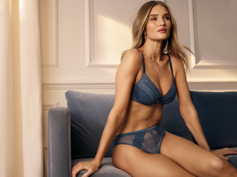 Clad in blue lace, Rosie Huntington-Whiteley models her Marks & Spencer lingerie collection for summer 2021.