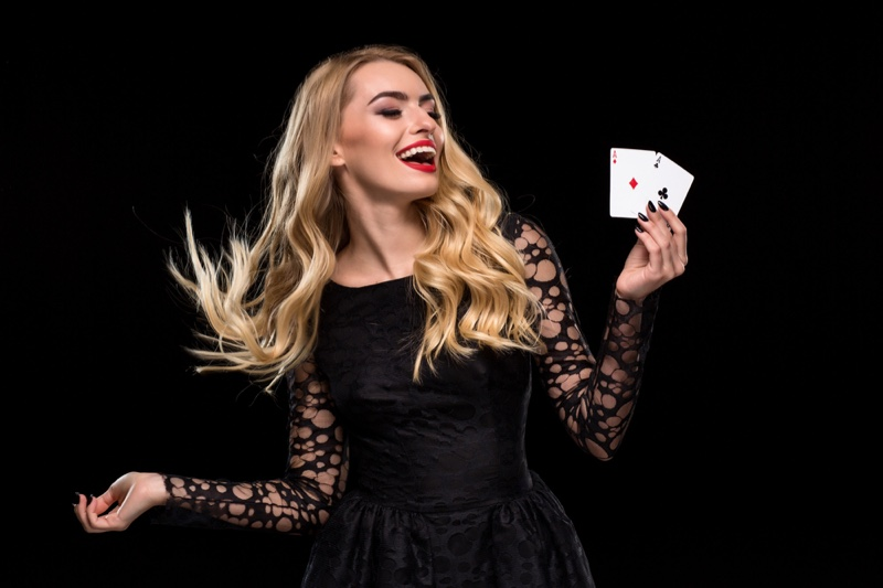 Smiling Blonde Woman Black Dress Two Ace Cards