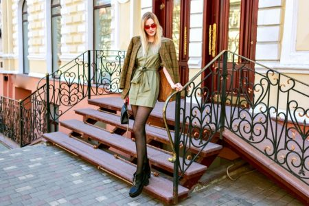 Stylish Influencer Green Dress Jacket Outfit Pose