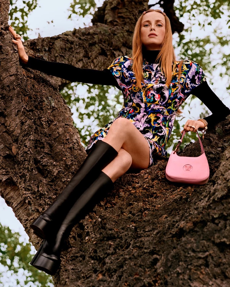Rianne van Rompaey poses in a tree for Versace pre-fall 2021 campaign.