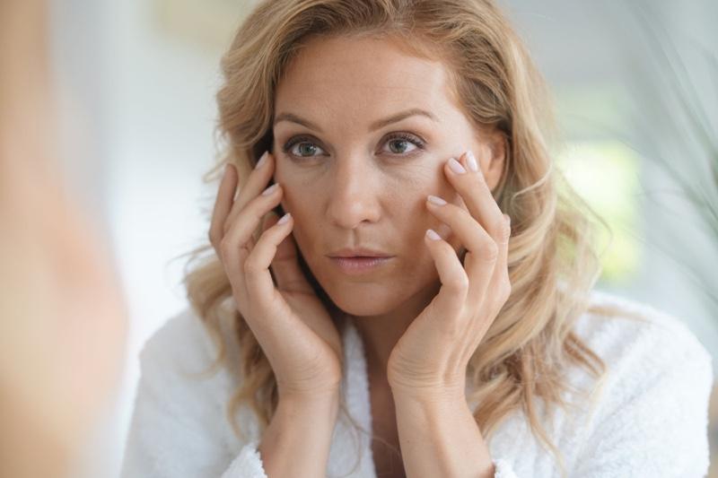 Woman Applying Anti-Aging Cream Face