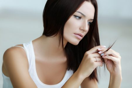 Woman Checking Hair Split Ends Thinning