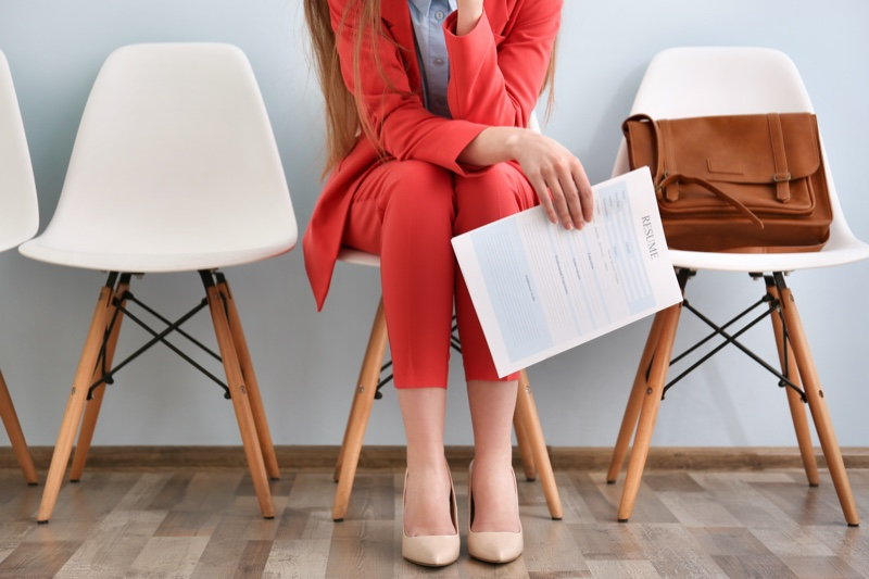 Woman Sitting Red Pant Suit Fashion Holding Resume Cropped