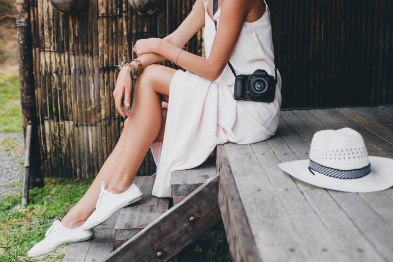 Woman Wearing Dress and Sneakers