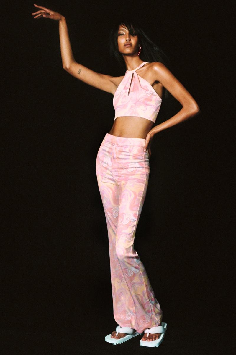 Mona Tougaard models Zara print crop top and printed flared pants.