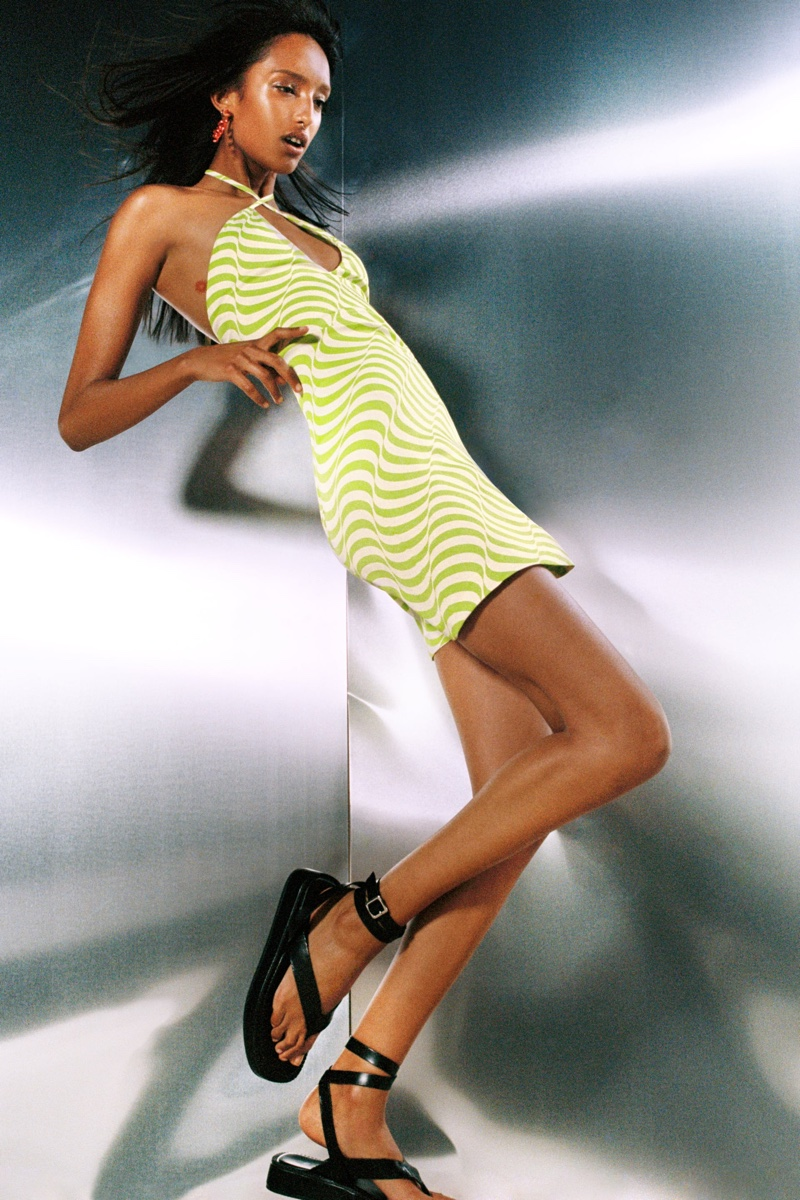 Zara highlights 2000s party style with satin effect print dress and tied flat leather sandals.