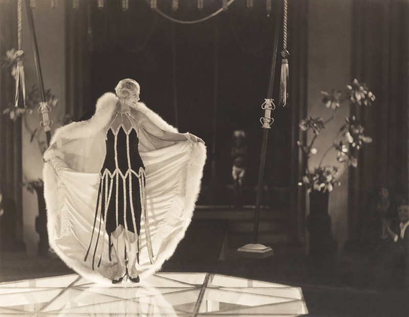 A model at a 1920s fashion show wearing a knee-length flapper dress. Photo: Shutterstock.com