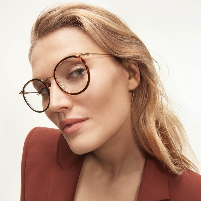 Toni Garrn wears round glasses from BOSS Eyewear.