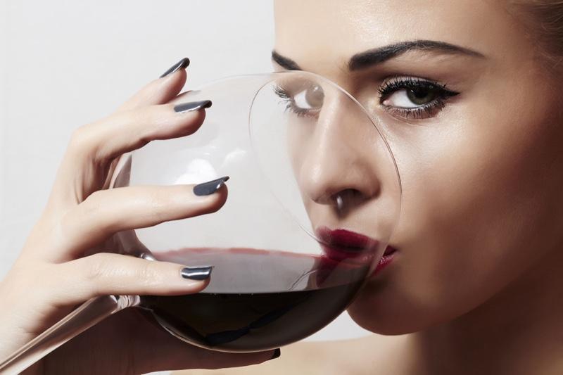 Closeup Model Drinking Wine Glass