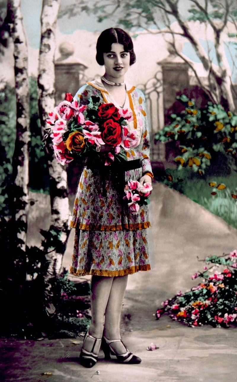 This colorized image shows 1920s woman in a flapper dress.