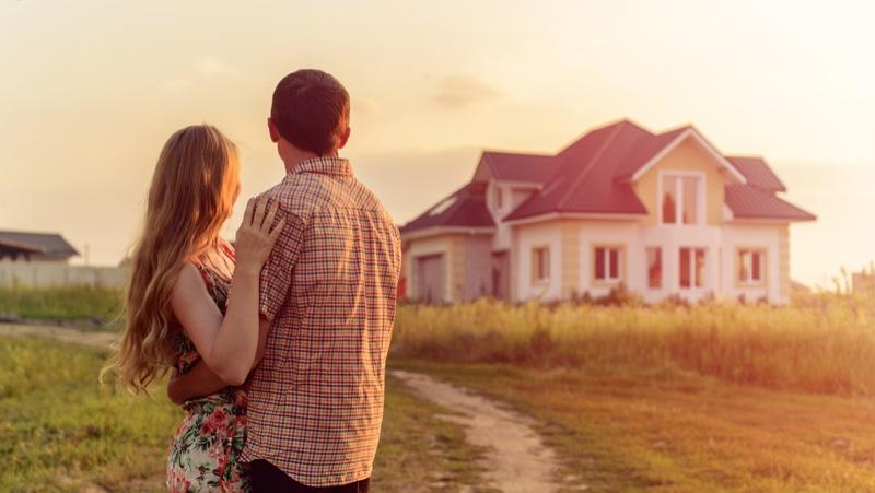 Couple Embracing Outside House