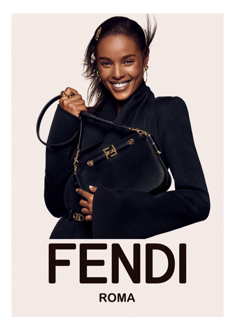 Malika Louback flashes a smile in Fendi fall-winter 2021 campaign.