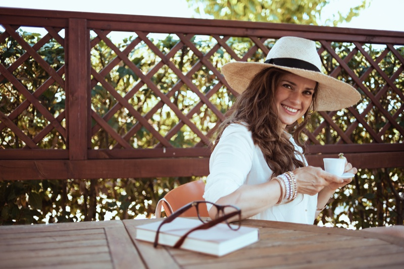 Happy Woman Straw Hat Coffee Cup Relaxed Cottage