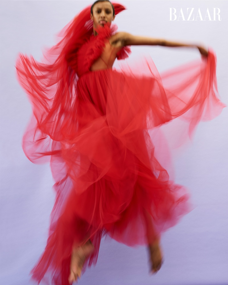 Courtney Celeste Spears of Alvin Ailey American Dance Theater shows her moves in red Dior dress.